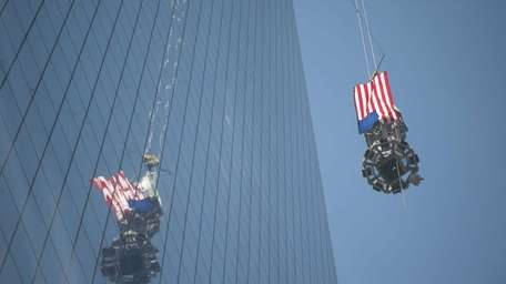 Crews at the World Trade Center raise the