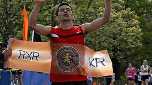 Men's marathon winner Emiliano Garcia, of Astoria, crosses