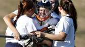 Rocky Point girls lacrosse teammates surround goalie Shannon