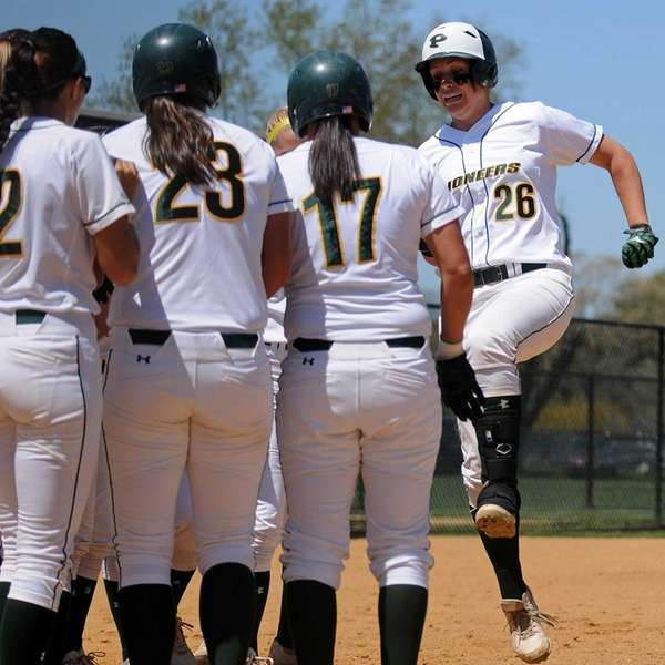 LIU Post catcher Aly Dzierzynski, right, gets greeted