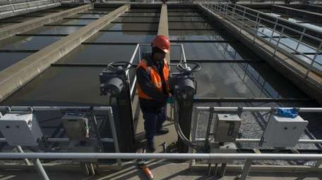 A worker replaces motors and local control panels