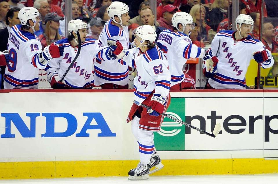 Carl Hagelin of the Rangers celebrates with teammates