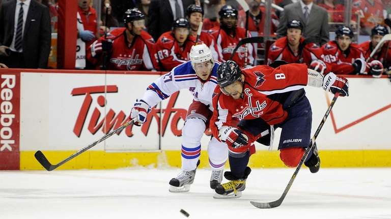 Alex Ovechkin of the Washington Capitals battles for