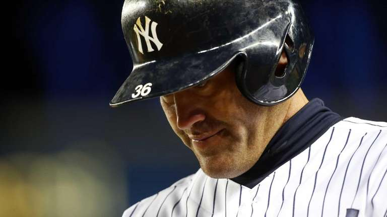 Kevin Youkilis looks on after grounding out in