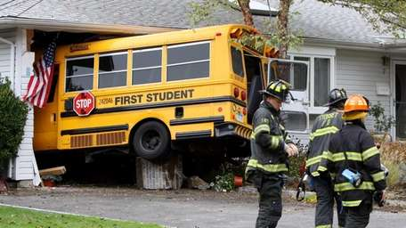 A school bus crashed into the garage of