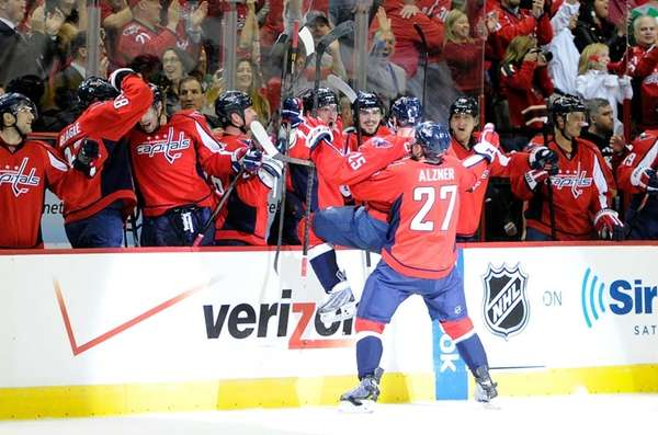 The Washington Capitals' Jason Chimera celebrates with teammates