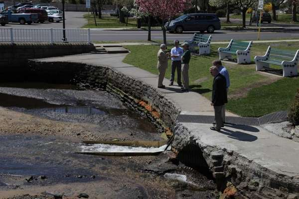 People stand a new fishway installed at Argyle