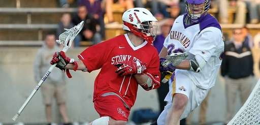 Stony Brook's Mike Rooney moves behind the net