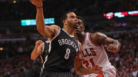 Deron Williams of the Nets drives past Jimmy