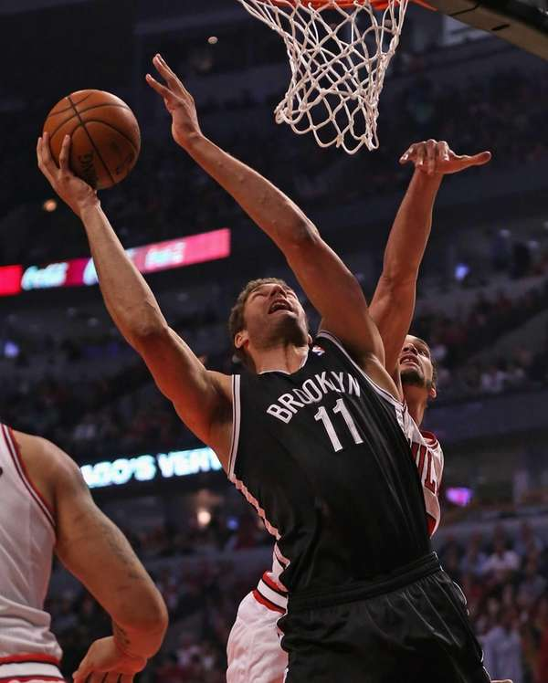 Brook Lopez of the Nets shoots past Joakim