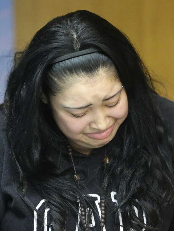 Johana Portillo, Riccardo Portillo's oldest daughter, cries during