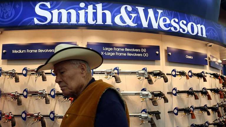 An attendee walks through the Smith & Wesson