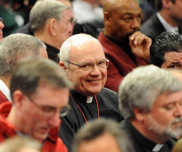 St. John's University president Rev. Donald Harrington takes