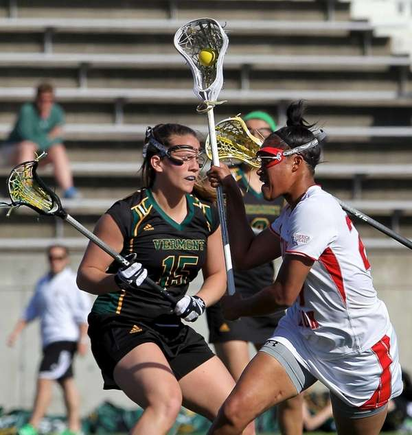 Stony Brook's Demmianne Cook splits the Vermont defense