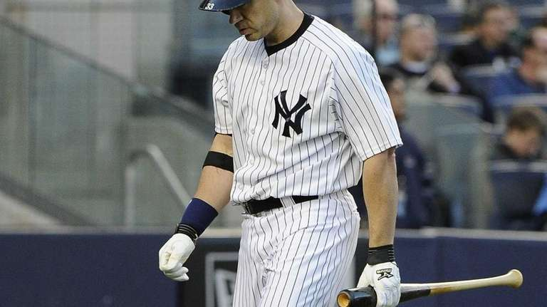 Yankees' Travis Hafner walks off after he strikes