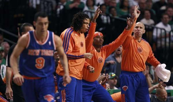 Knicks guard Jason Kidd, right, celebrates a three-point