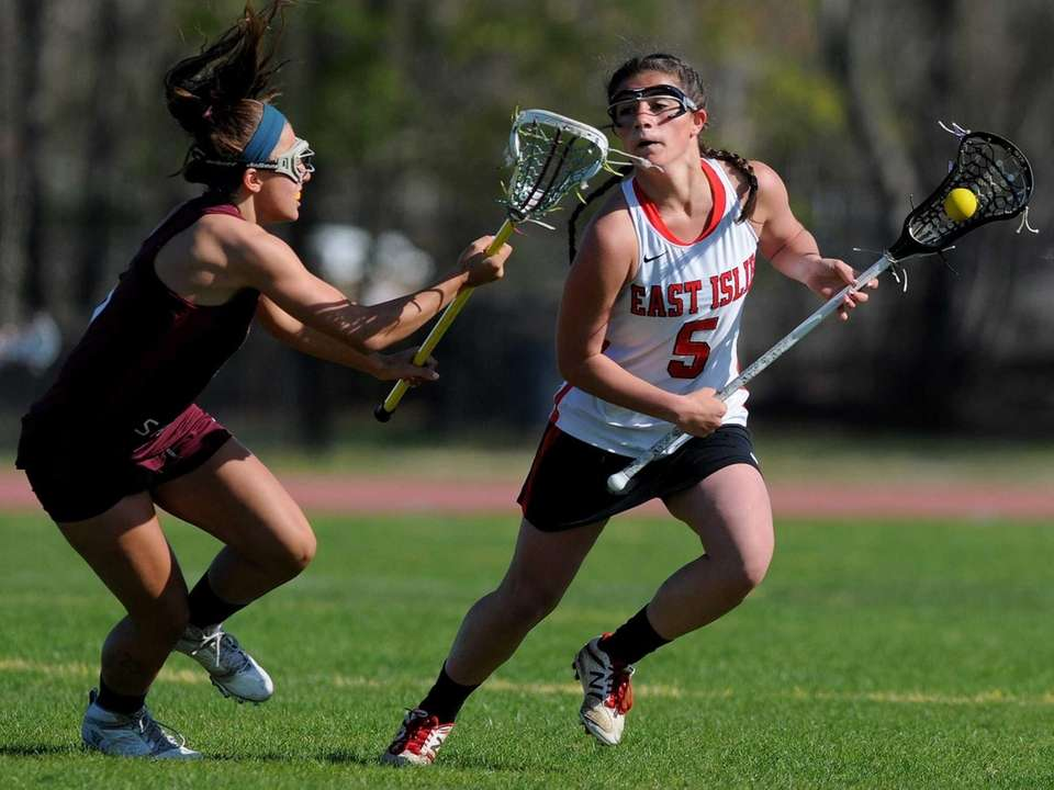 East Islip junior Carlee Ancona, right, gets pressured