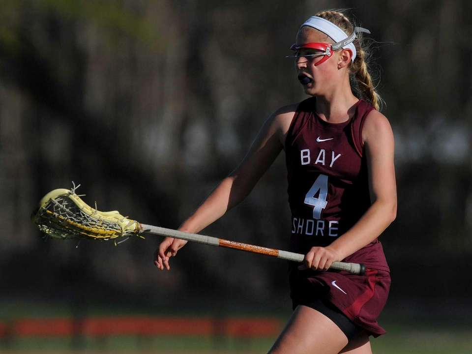 Bay Shore junior Erin Ilchuk carries downfield during