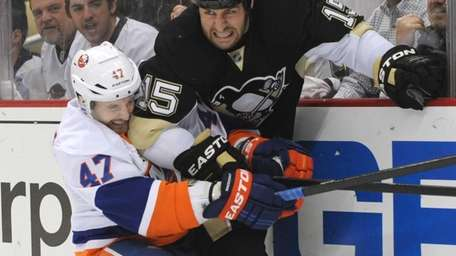 Andrew MacDonald of the Islanders and Tanner Glass