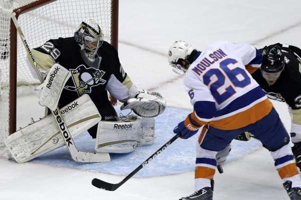 Islanders'  Matt Moulson can't get his stick on a rebound in front of Pittsburgh Penguins goalie Marc-Andre Fleury during the first period of Game 1 of an NHL first-round playoff series. (May 3, 2013)