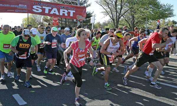 Runners take off at the start of the