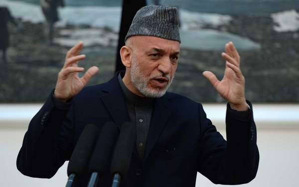 Afghanistan President Hamid Karzai gestures as he addresses