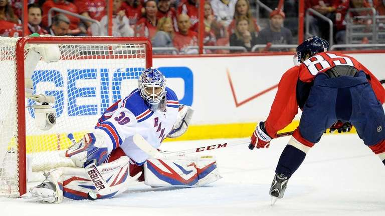 Henrik Lundqvist of the Rangers makes a save