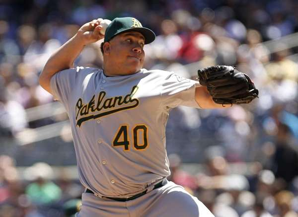 Bartolo Colon of the Oakland Athletics pitches in