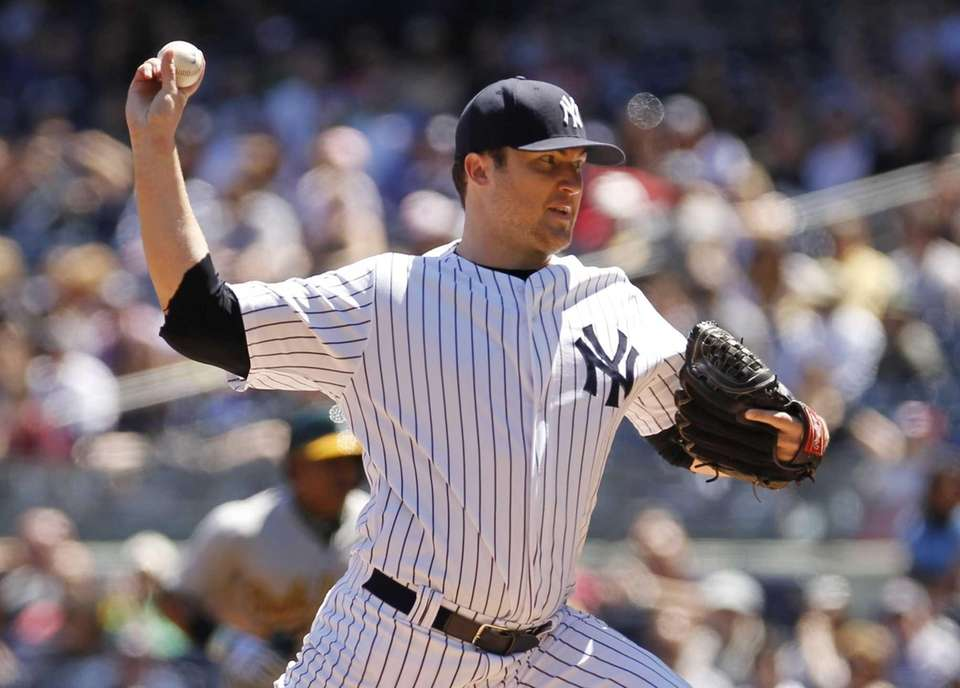 Phil Hughes of the Yankees pitches in the