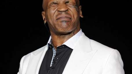 Mike Tyson performs during the grand opening of