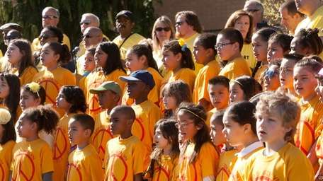 Children from Freeport schools sing a song about