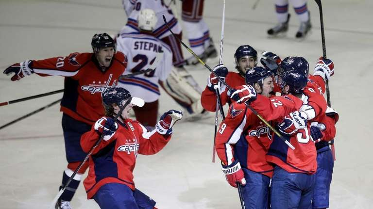 Washington Capitals defenseman Mike Green, right, is congratulated