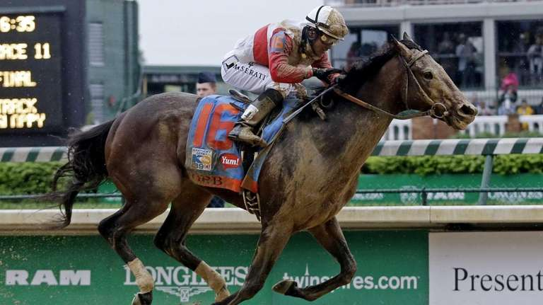 Joel Rosario rides Orb during the 139th Kentucky