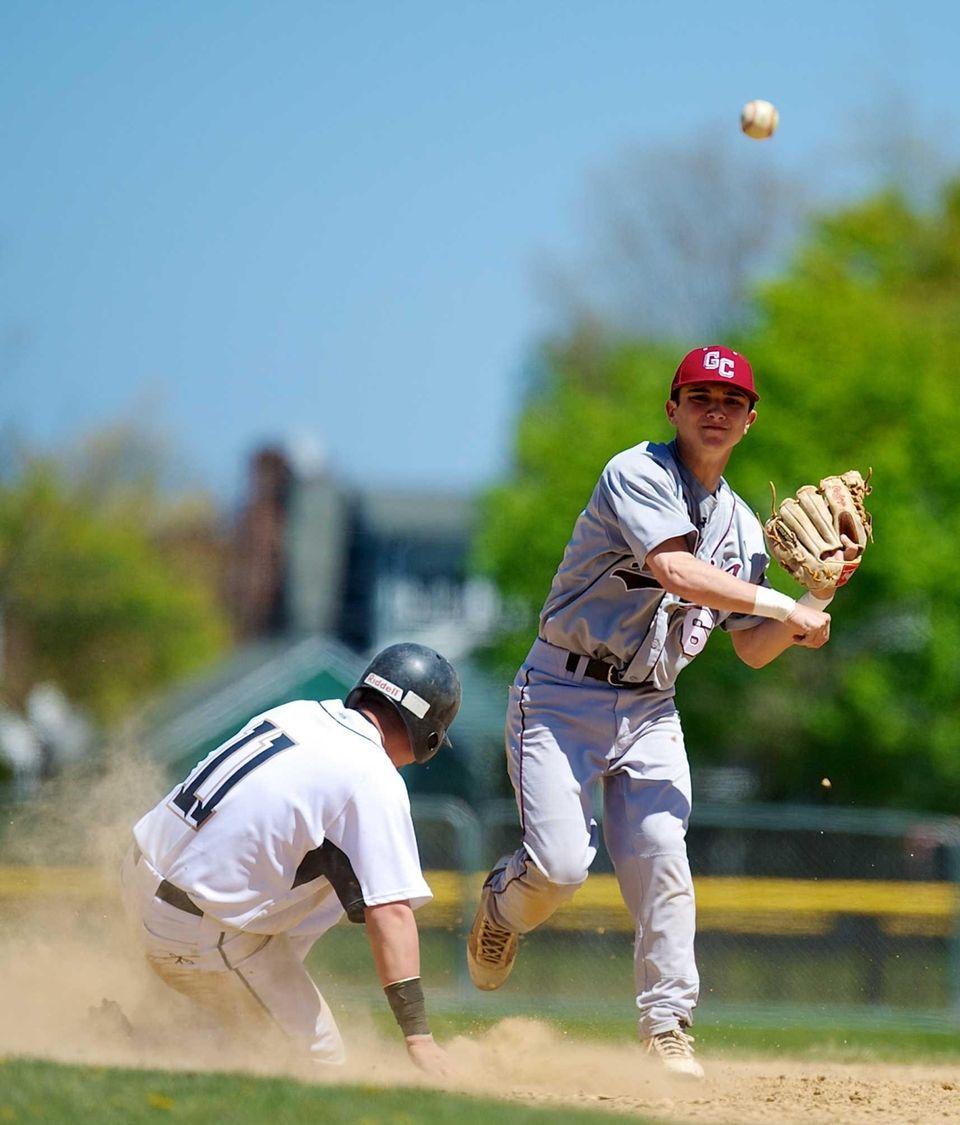 Garden City second baseman John Cauchi turns a