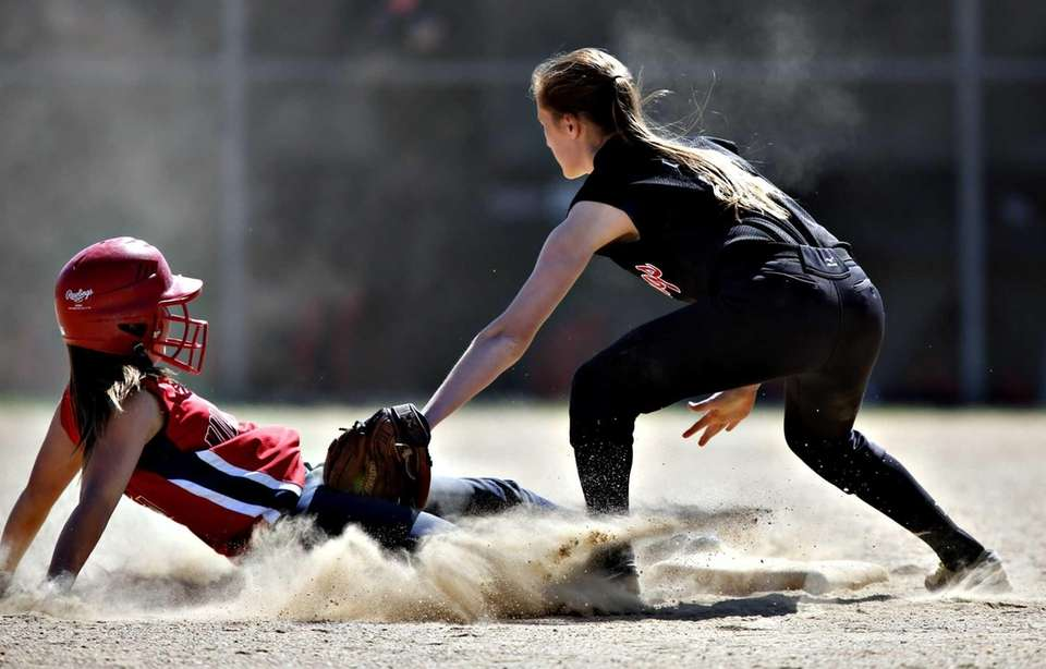 Miller Place's Tori Carlo beats the tag by