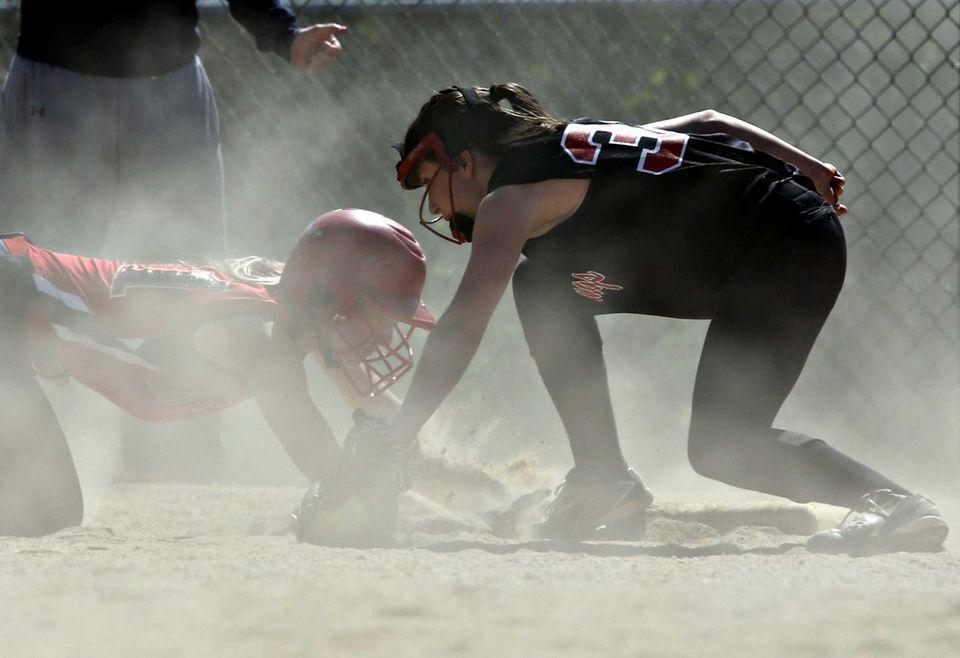Miller Place's Allie Krumholz scrambles back to third
