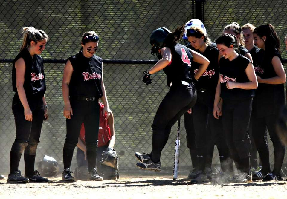 Mt. Sinai softball players wait at home as