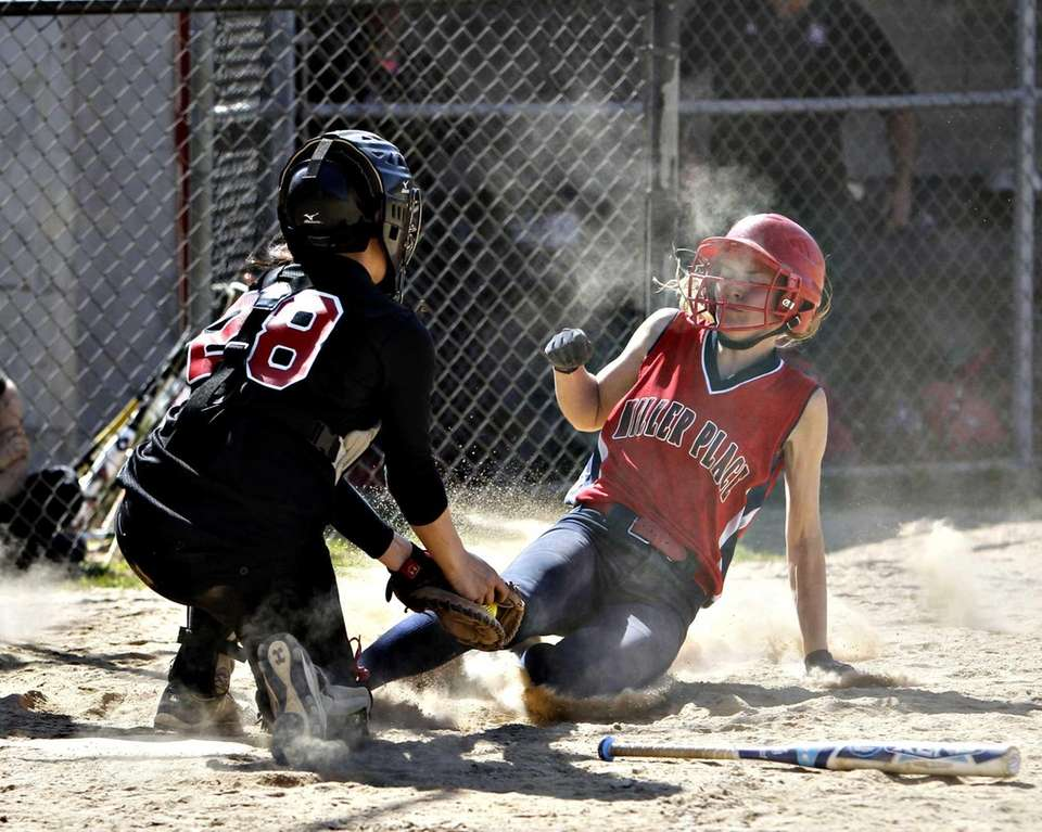 Mt. Sinai catcher Samantha Roser puts the tag