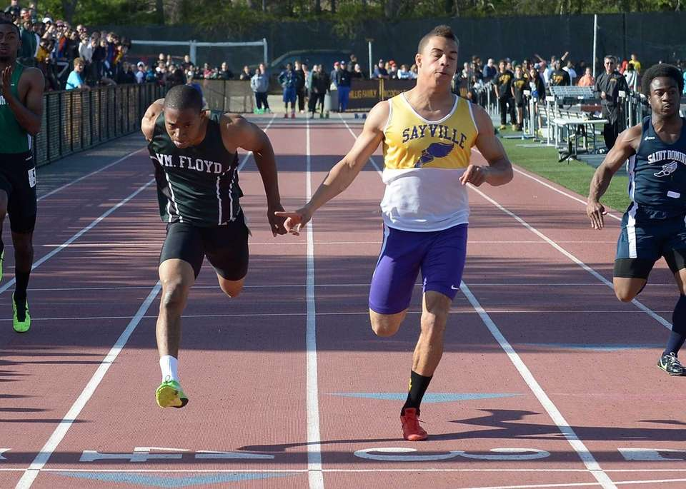 Sayville's Christopher Belcher (10.84 seconds) wins the 100