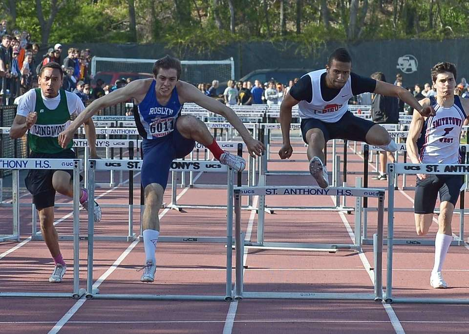 Roslyn's Luke Pascale, left, wins the 100 meter