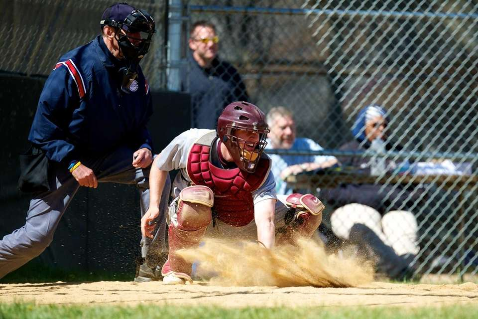 Garden City catcher P.J. Volz blocks a ball