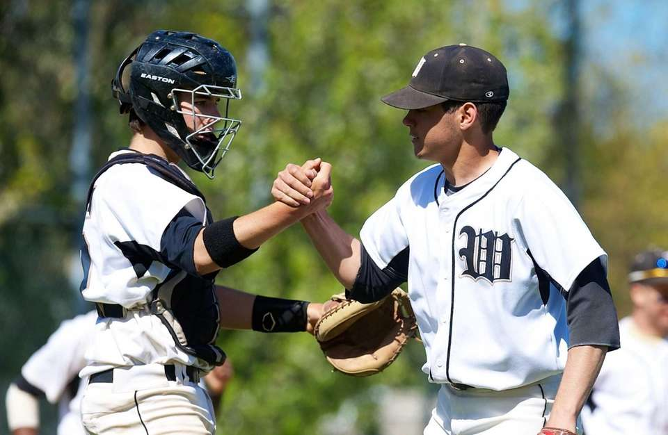 Wantagh pitcher Adam Aponte (10) celebrates with catcher
