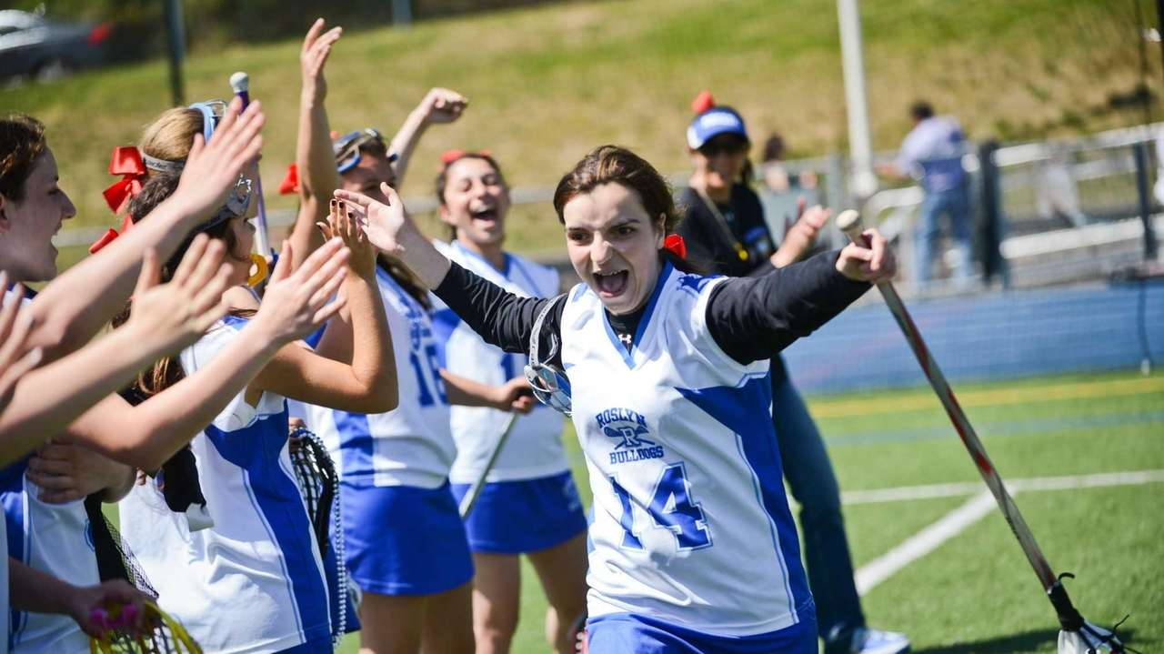 Teammates cheer as Katherine Zisis is introduced as