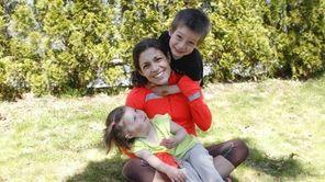 Tara Farrell takes a break with her children