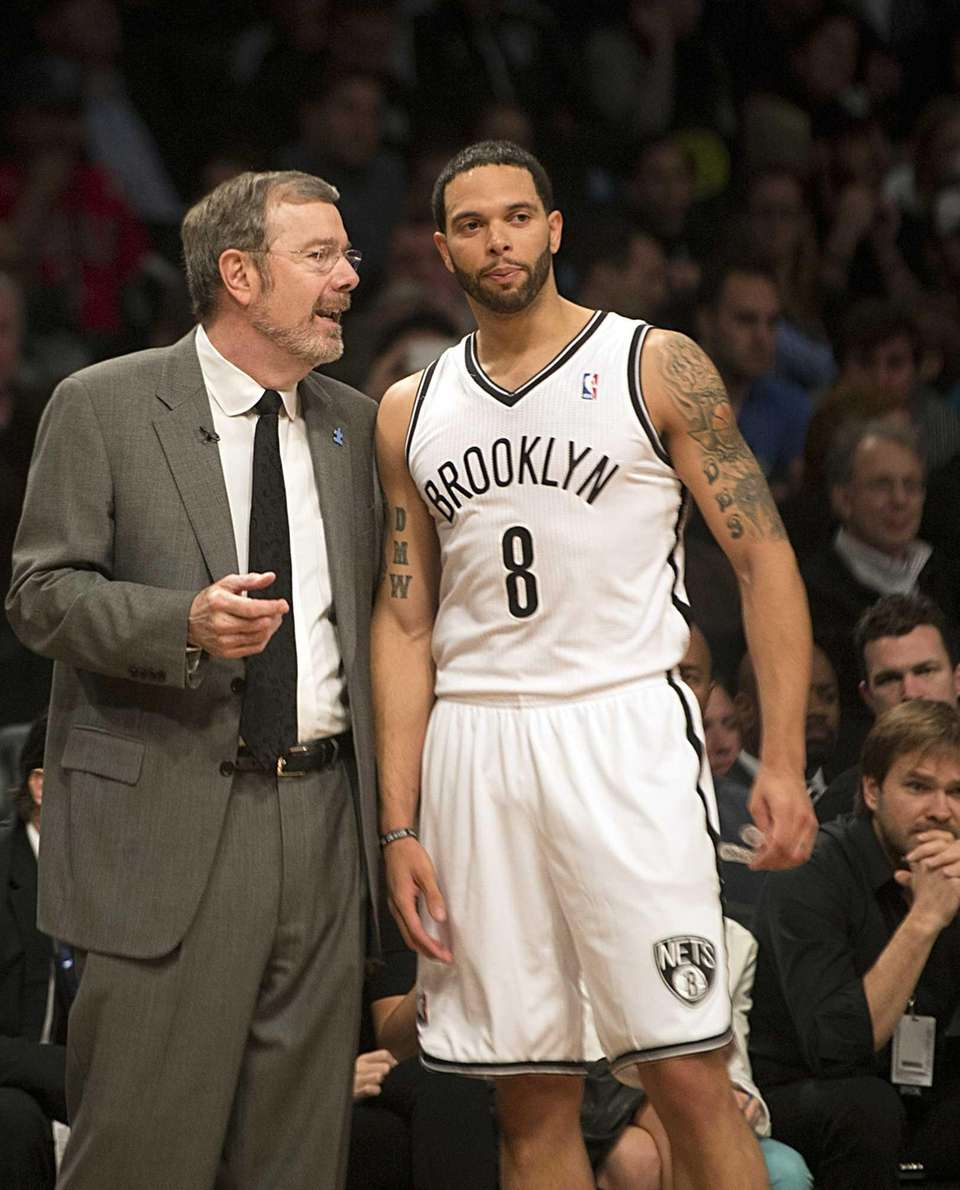 Nets interim coach P.J. Carlesimo talks with Deron