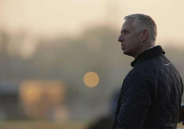 Trainer Todd Pletcher watches some morning workouts at