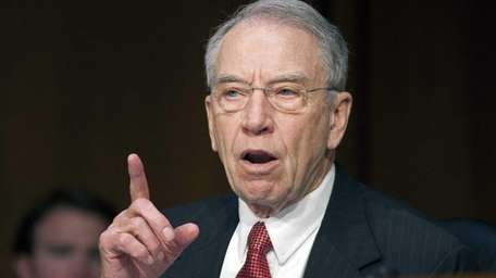 Sen. Charles Grassley, R-Iowa, questions a witness on