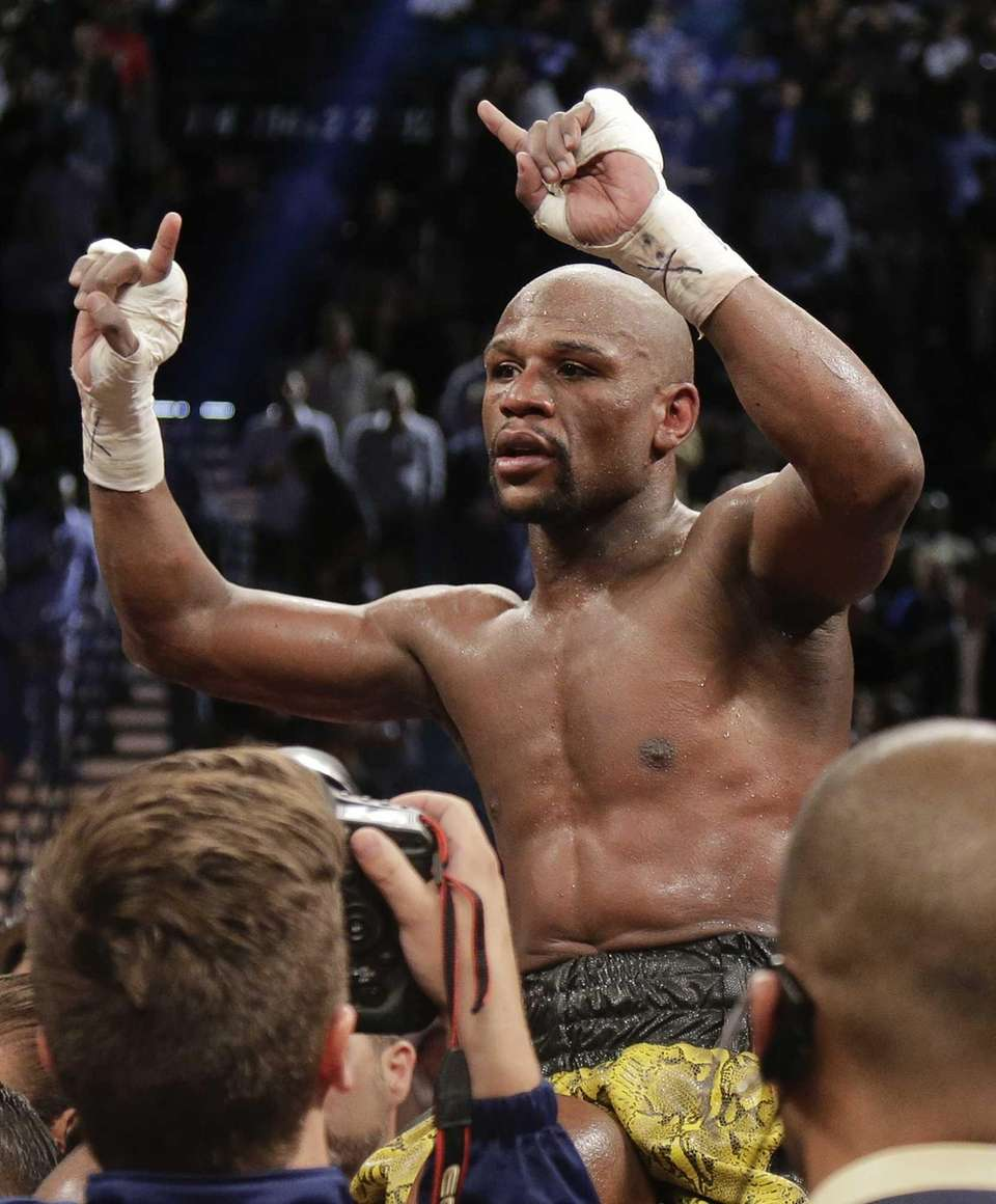 Floyd Mayweather Jr. reacts after defeating Robert Guerrero