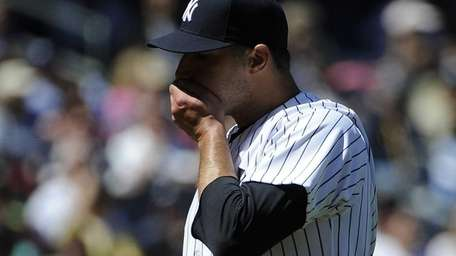 Andy Pettitte leaves the mound after the top