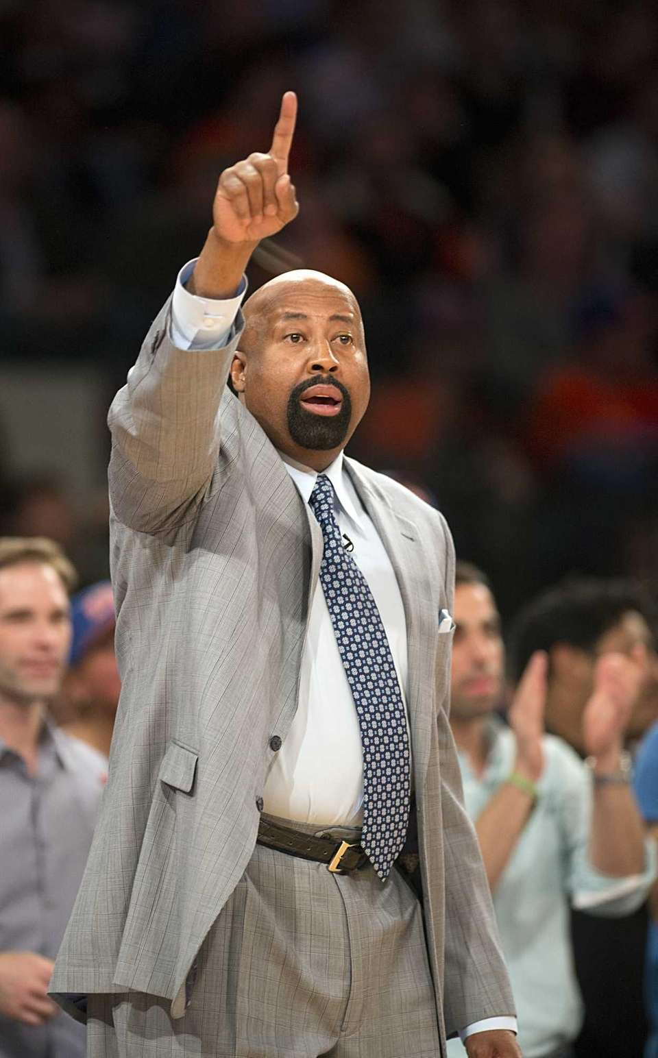 Mike Woodson yells to his team during Game